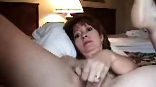 Mature non-specific masturbating on camera