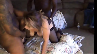 Amateur milf in stockings cums hard between two black cocks
