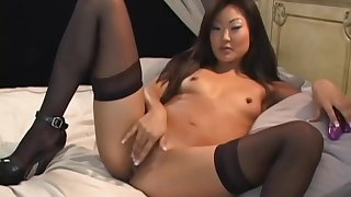 Slutty Asian engrave Lucy Lee plays in the air a dildo and gets fucked