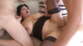 Well-endowed mature inferior undressed and fucked by duo younger guys